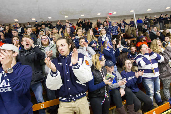 Lyman Hall Trojan fan section gets ready for the start with Woodstock Academy Thursday during the CIAC Division III semi finals at Ingalls Rink on the campus of Yale University in New Haven. Mar. 16, 2017 | Justin Weekes / For the Record-Journal