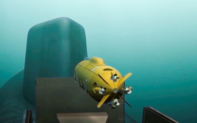 In this video grab provided by RU-RTR Russian television via AP television on Thursday, March 1, 2018, a computer simulation shows a Russian nuclear-powered underwater drone being released by a submarine. President Vladimir Putin declared Thursday that Russia has developed a range of new nuclear weapons, claiming they can