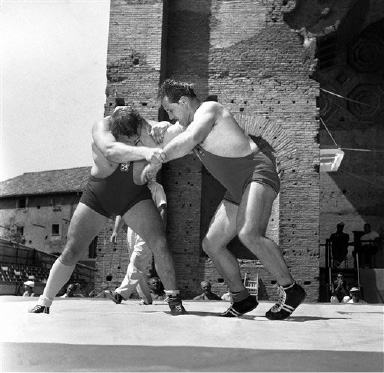 Bohumil Kubat (Czechslovakia), left, and Wilfried Dietrich (Germany) are seen in action during their Greco-Roman heavyweight bout of the Summer Olympic Games wrestling event on August 30, 1960 in Rome, Italy. (AP Photo/Raoul Fornezza)