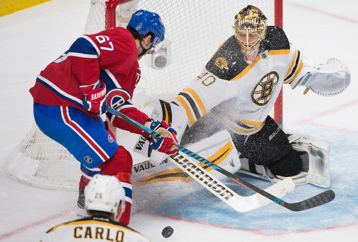 Boston Bruins goaltender Tuukka Rask makes a save against Montreal Canadiens captain Max Pacioretty during first period NHL hockey action in Montreal, Monday, Dec. 12, 2016. (Graham Hughes/The Canadian Press via AP)