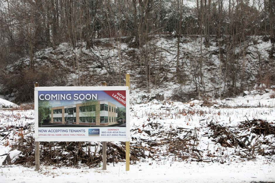 A sign posted on land at 1336 E. Main St. in Meriden, Wednesday, Jan. 17, 2018. A Rockfall developer won Planning Commission approval to build a two-story office building on the vacant lot located next to the Family Dollar store. Dave Zajac, Record-Journal