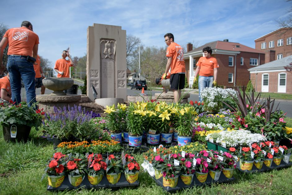 The Home Depot team works on Veterans Memorial Boulevard. Meriden Mayor Scarpati and the Council of Neighborhoods put on their annual Mayor