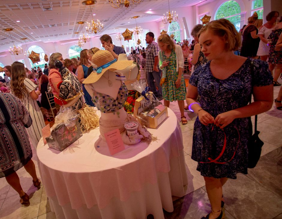 "Sarah Day, of Glastonbury, eyes up the ""Beach Therapy"" bra on the raffle table during the Art Bra 2018 fundraiser at the Aqua Turf Aug. 9, 2018. 