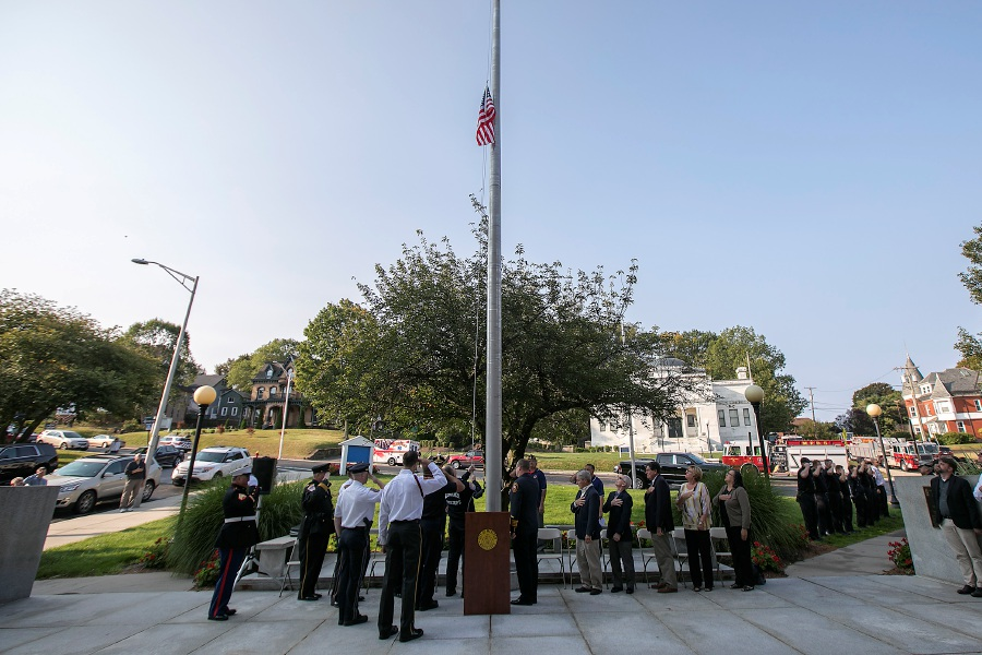 9/11 Capt. Steve Schoeck raises an American flag that flew over ground zero during the annual 9/11 remembrance ceremony at Meriden City Hall, Monday, Sept. 11, 2017. | Dave Zajac, Record-Journal