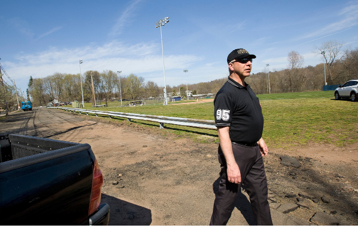 Mike Melkonian, of Wallingford, arrives to umpire a Lyman Hall vs Bullard-Havens  baseball game at Pat Wall field in Wallingford, Monday, April 18, 2016. The Planning and Zoning Commission approved a plan to expand the parking area at Pat Wall Field.   |  Dave Zajac / Record-Journal
