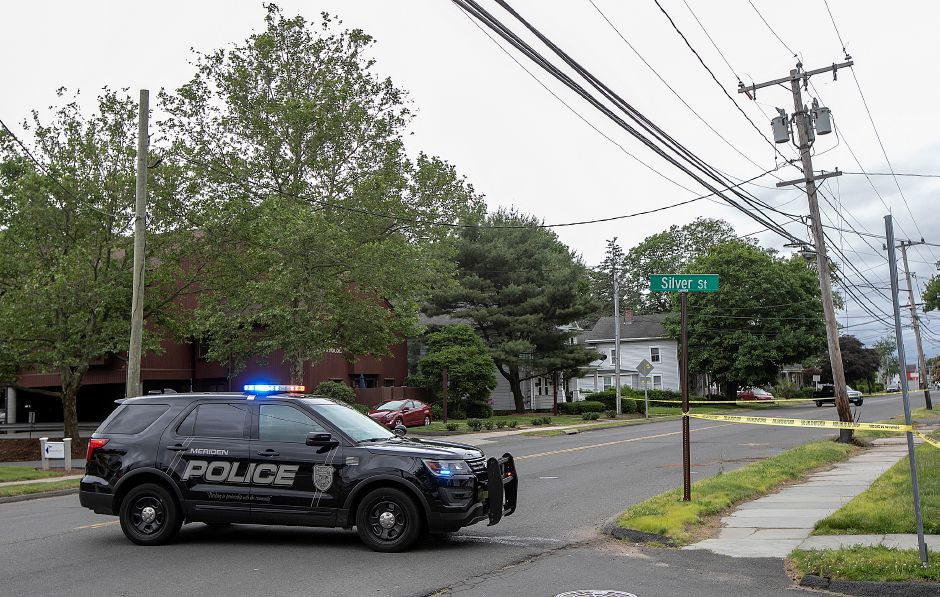 Police block the road after a utility pole was damaged by a motor vehicle on Broad Street near Silver Street in Meriden, Mon., June 10, 2019. Silver Street to Ann Street is closed to traffic after police said a car crashed into a pole and the driver attempted to flee the scene. Dave Zajac, Record-Journal