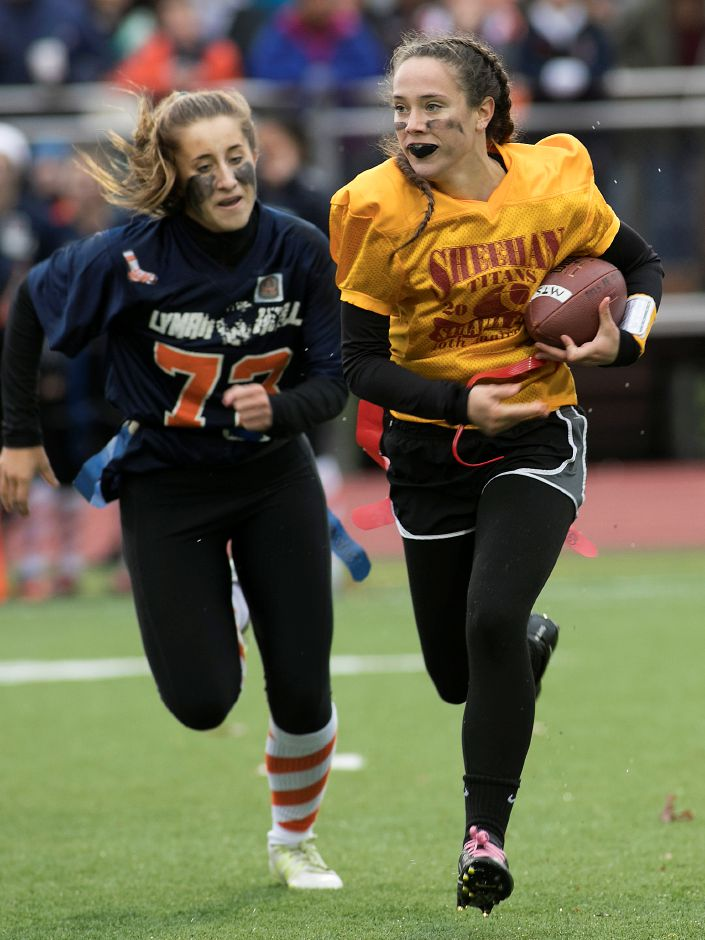 Sheehan quarterback Stephanie Phoenix, right, opts for a run as Lyman Hall