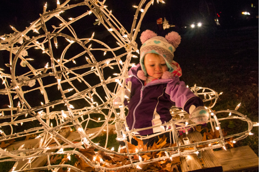 Quinn Talento, 1, of Meriden makes herself at home in a lighted camel during the Festival of Silver Lights in Hubbard Park Tuesday Nov. 24, 2015. | Richie Rathsack/Record-Journal
