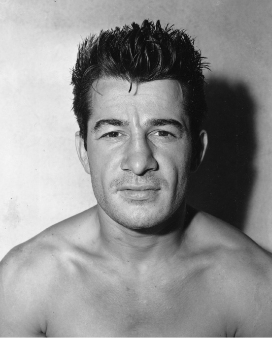 Middleweight boxer Rocky Graziano, of Brooklyn, N.Y., poses at his training camp in Greenwood Lake, N.J., on July 16, 1946.  (AP Photo)