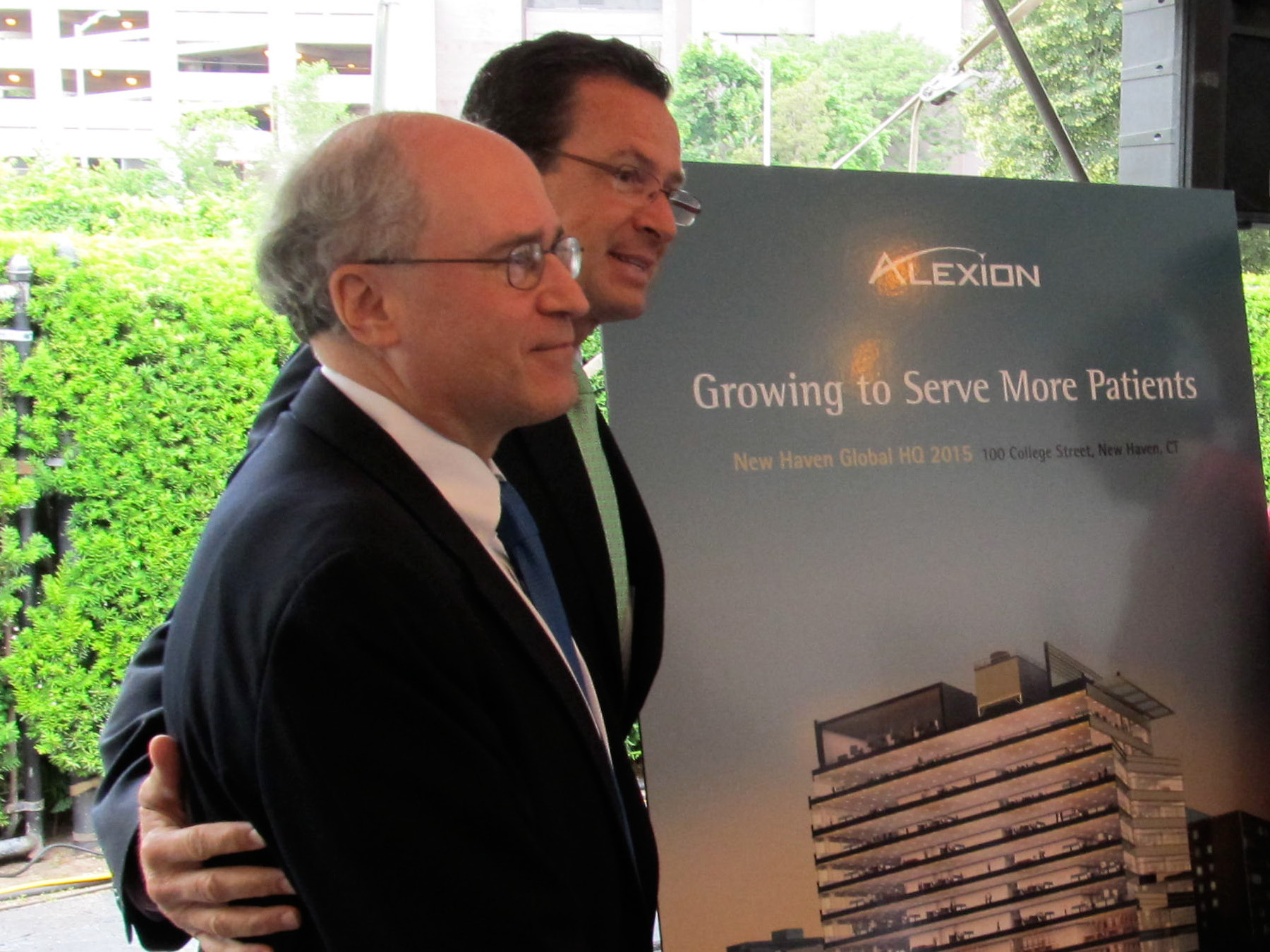 FILE PHOTO -- Gov. Dannel P. Malloy with Dr. Leonard Bell, the former CEO of Alexion.
