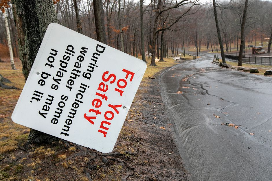 A park safety sign fallen over at the entrance to Hubbard Park during heavy rains in Meriden, Fri., Dec. 21, 2018. Dave Zajac, Record-Journal