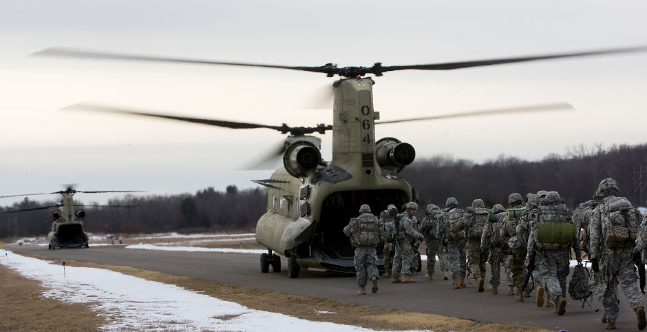 Two massive military CH-47 Chinook helicopters stop at Meriden-Markham Airport to pick up 44 Connecticut National Guard infantry soldiers to deliver them to training in New Jersey, on Feb. 3.  Dave Zajac, Record-Journal