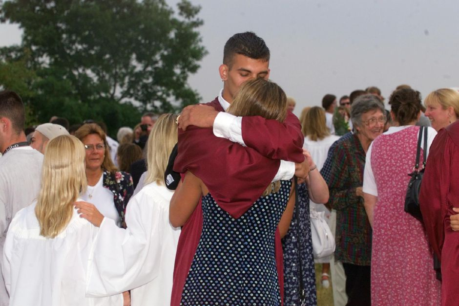 RJ file photo - Gary Stanley, a new graduate at Sheehan High School in Wallingford, hugs his girlfriend Shelly Boucher, a student at Lyman Hall High School in Wallingford after ceremonies at Sheehan June 25, 1999.