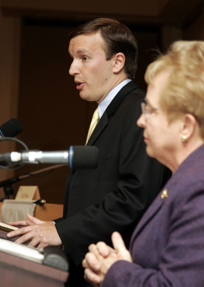 Chris Murphy, left, gives his opening remarks Mon., Oct. 23 at the Ct. Grand Hotel in Waterbury during a debate with Nancy Johnson, right, sponsored by the Waterbury Regional Chamber.