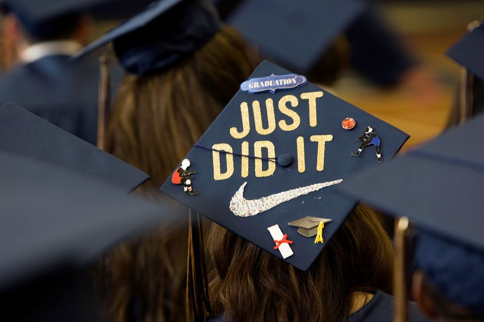 "Graduate Ashley Rios dons a cap ""Just Did It"" before the start of graduation ceremonies at Platt High School in Meriden, Friday, June 19, 2015. 