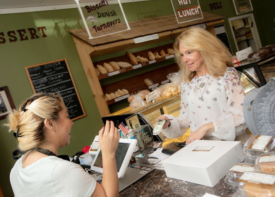 Michele Loveland, of Middletown, right, buys a dessert pie from cashier Yesenia De Luna at The Bakery On The Ave. in Berlin, Wed., June 12, 2019. Bakery owner Enzo Formica is planning to open another location on Center Street in downtown Southington next month. Dave Zajac, Record-Journal