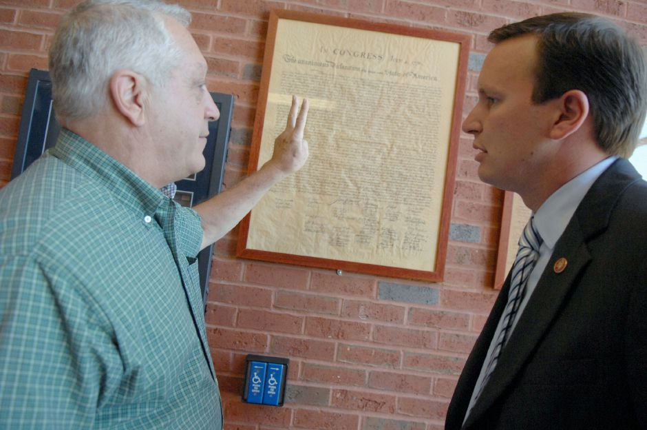 CHESHIRE, Connecticut - Monday, September 8, 2008 - Cheshire native and former Cheshire High School teacher John White, left, talks with U.S. State Rep Chris Murphy in front of the display of the Declaration of Independance at the Main Entrance of Cheshire High School on Monday, September 8, 2008. White first suggested to Murphy that these important documents be shown in schools for all students to observe and remember what our country was founded upon. Framed replicas of the documents have now been displayed at all Cheshire Schools. Rep. Murphy will be pushing for federal legislation in Washington D.C. to display the Constitution, Bill of Rights and the Declaration of Independance in all schools across the country. Rob Beecher / Record-Journal