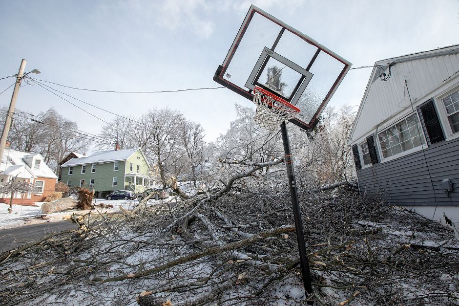 Fallen tree limbs cover the front yard at 45 Pine St. in Wallingford on Monday. See more photos at myrecordjournal.com