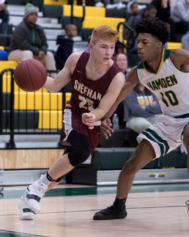 Sheehan's Arthur Cordes drives past Hamden's Justin Radford Thursday during the opening round of the SCC tournament at Hamden High School.