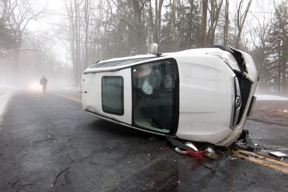 Emergency crews responded to a car rollover on Cheshire Road in Wallingford Friday morning. Police said speed and fog were factors in the accident, which resulted in hand injuries to the driver. | Devin Leith-Yessian/Record-Journal