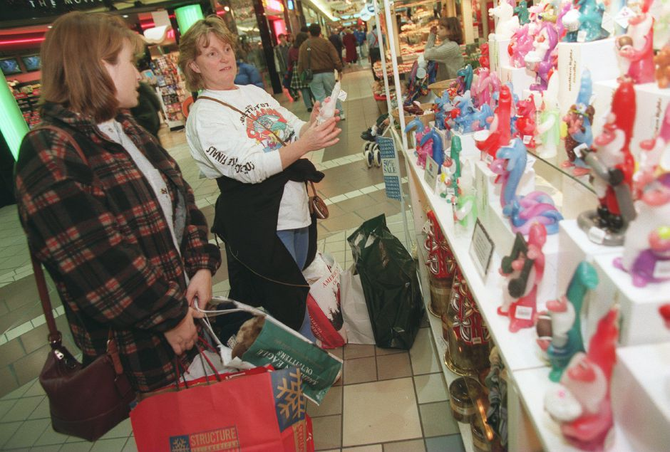 RJ file photo - Kathleen Guerrera, left, and Arleen Sarno, both from Hamden, look at candles at a kiosk at the Meriden Square mall Dec. 15, 1998.