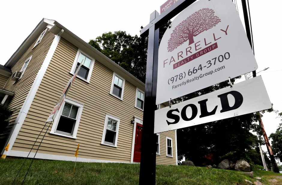 In this Tuesday, Aug. 21, 2018 photo, a home has a sold sign in North Reading, Mass. On Wednesday, Aug. 22, the National Association of Realtors reports on sales of existing homes in July. (AP Photo/Elise Amendola)