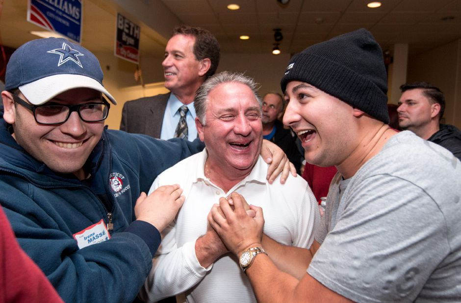 Bob Williams, center, Republican candidate for Area Four, celebrates with City Councilor Joe Carabetta, right, and Mike Picone, left. The unofficial results predicted William winning over Democratic candidate Darius Riddle. | Devin Leith-Yessian/Special to the Record -Journal