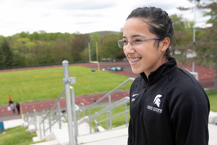 Coralis Soto, 17, prepares to take track practice at Maloney High School, Tues., May 14, 2019. Soto moved to Meriden from Puerto Rico with her mother, father and sister after Hurricane Maria in 2017. Soto, a standout in both distance and sprint running, has only been with the track team for one season. Dave Zajac, Record-Journal