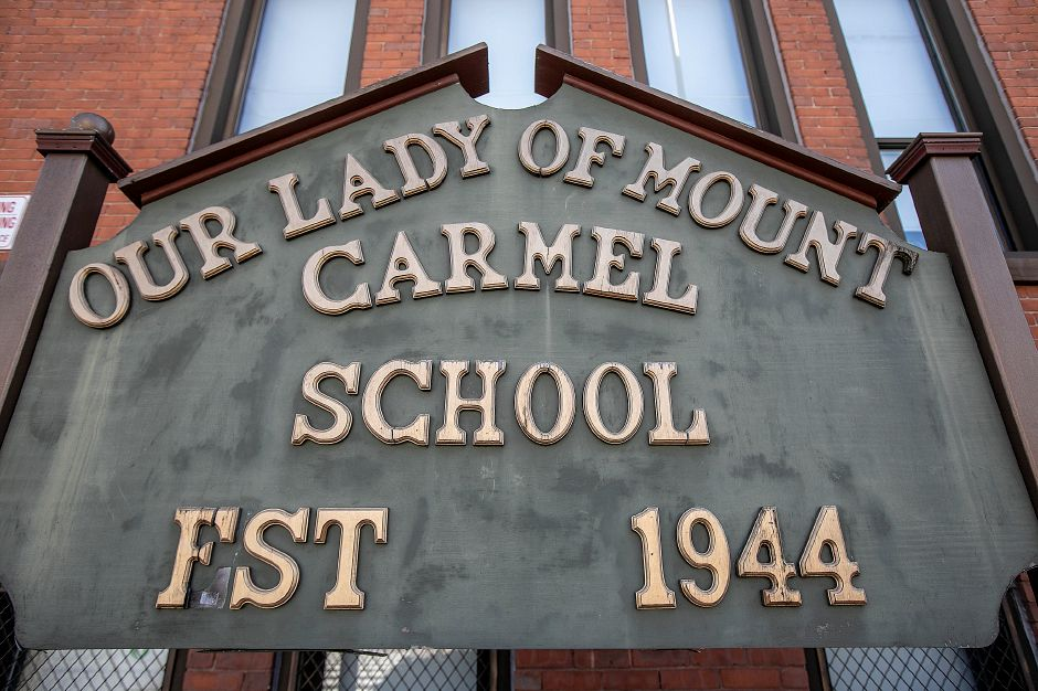 A sign in front of Our Lady of Mount Carmel School in Meriden, Thurs., Apr. 4, 2019. The school is celebrating 75 years. Dave Zajac, Record-Journal