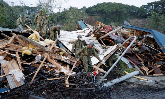 Japan Ground Self-Defense Force personnel shift through debris as they search for missing persons at the site of a landslide triggered by a powerful earthquake in Atsuma town, Hokkaido, northern Japan, Friday, Sept. 7, 2018. A powerful earthquake Thursday on Japan