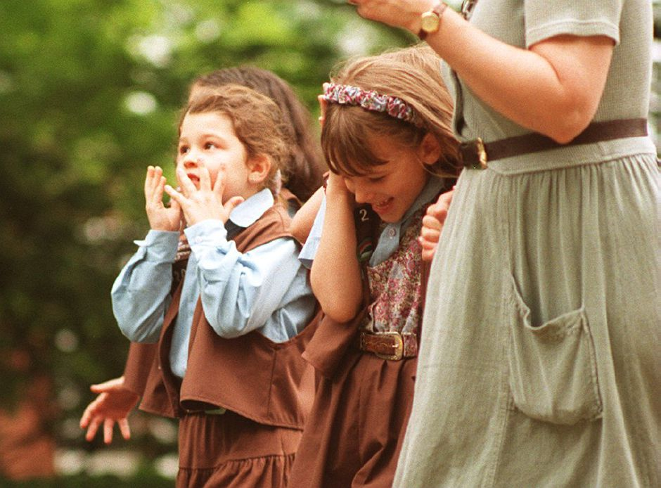 RJ file photo - Girl Scouts from Rock Hill Troop 620 react to a clap of thunder and flash of lightning during the Wallingford Memorial Day parade, May 25, 1998.