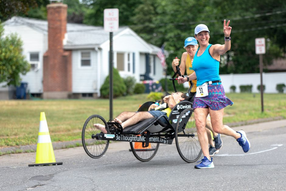 Alice Carrillo runs down Locust Street during the Chips Family Restaurant Road Race on July 21, 2019. The run started on East Street in front of Plainville High School and ended on Robert Holcomb Way. | Devin Leith-Yessian/Plainville Citizen