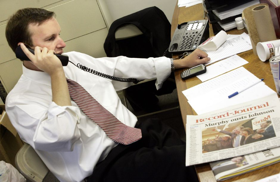 Chris Murphy in his New Britain Headquarters Wed. morning, Nov. 8 with one of his supporters on the phone.