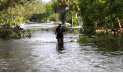 Rhori Cameron walks though his flooded neighborhood, in the aftermath of Hurricane Irma in Bonita Springs, Fla., Monday, Sept. 11, 2017. (AP Photo/Gerald Herbert)