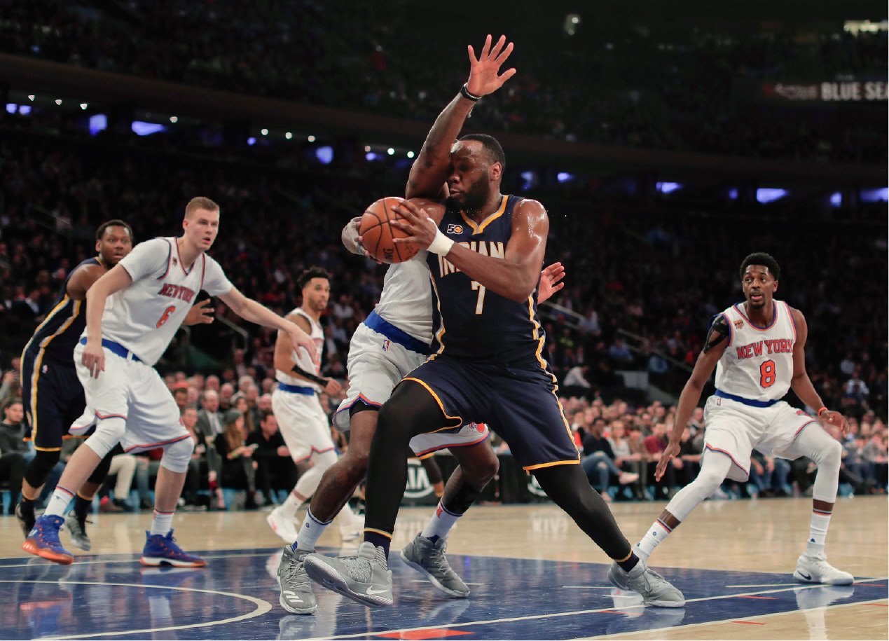 Indiana Pacers center Al Jefferson (7) drives against New York Knicks center Kyle O