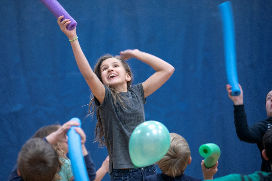 Tiffani Bennett, 11, of Wallingford, bats balloons during a game of kaboom-ball with the Storm Club at the Wallingford YMCA on Tuesday. The Storm Club runs when the public schools are closed due to inclement weather. Photos by Dave Zajac, Record-Journal