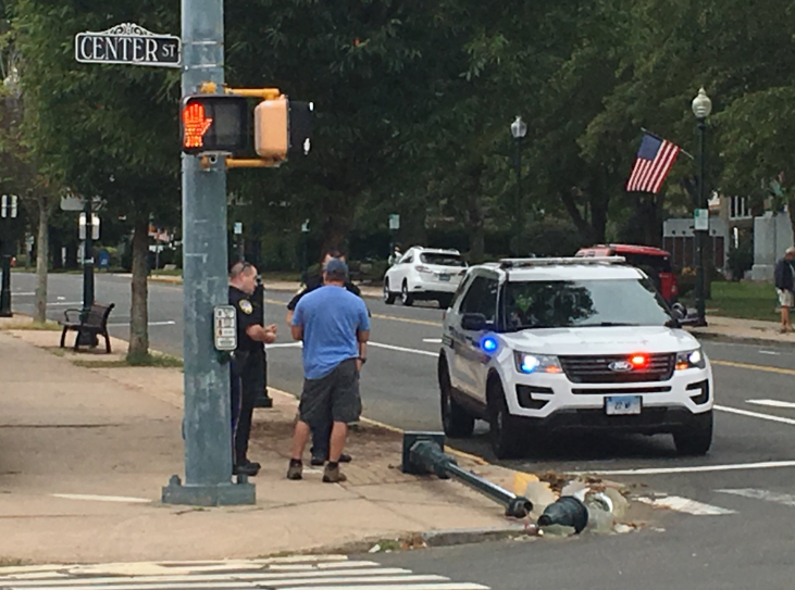 A lamp post was knocked over when a parked vehicle experienced a parking brake malfunction and rolled down South Main Street in Wallingford on Sept. 9, 2018. | Lauren Takores/Record-Journal