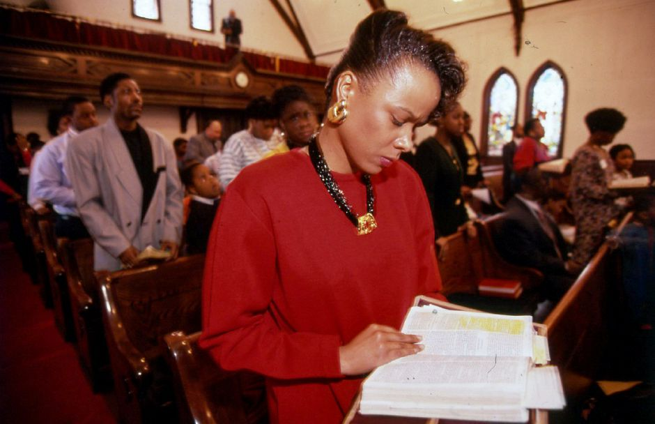 RJ file photo - Felisa Boyd follows a scripture reading at the Main Street Baptist Church in Meriden during the 4th annual youth crusade of the Faith Center Church of God in Christ, Feb. 1994.