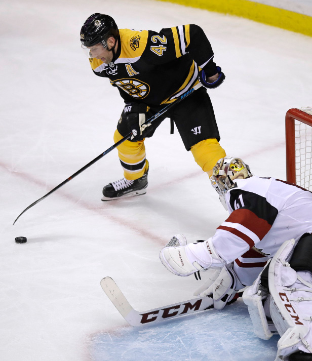 Arizona Coyotes goalie Mike Smith (41) drops his stick to the ice to block a shot by Boston Bruins right wing David Backes (42) during the first period of an NHL hockey game in Boston, Tuesday, Feb. 28, 2017. (AP Photo/Charles Krupa)