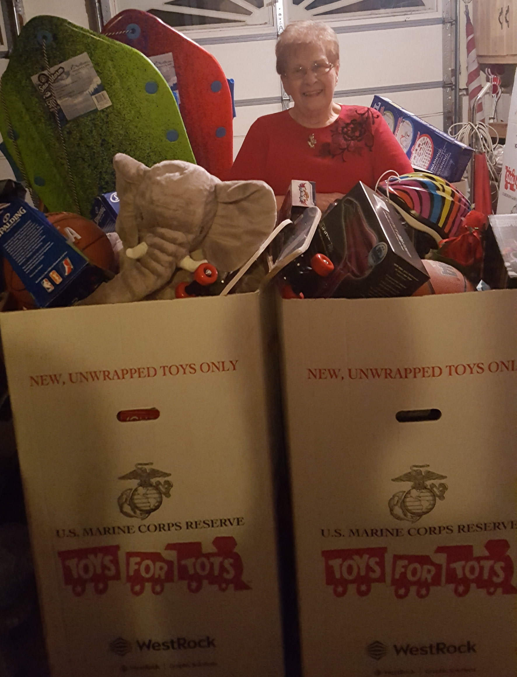 Joan Dorio, of Southington, stands in front of boxes of toys that will be donated to Toys for Tots. The donations were collected during an annual holiday party she holds at her house.