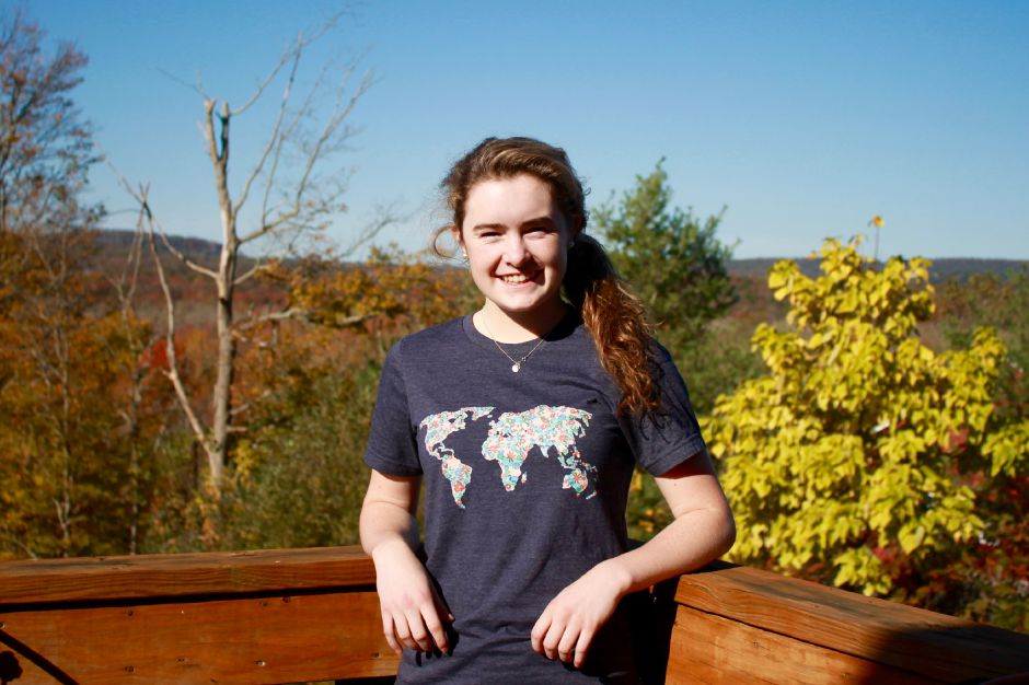 Durham teenager Kaitlyn Leahy launched a t-shirt business this year to help in the fight against hunger. Leahy is pictured wearing one of her Heart over Hunger shirts. | Mark Dionne, Town Times