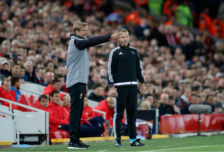 Liverpool coach Juergen Klopp gives instructions during the Champions League group E soccer match between Liverpool and Sevilla at Anfield stadium in Liverpool, England, Wednesday, Sept. 13, 2017. (AP Photo/Frank Augstein)