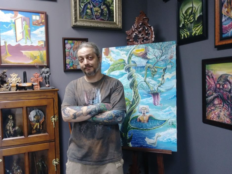 Anthony Plaza stands next to his art at Casanova Ink at 775 North Colony Road in Wallingford, Friday August 31, 2018. Jeniece Roman, Record-Journal.