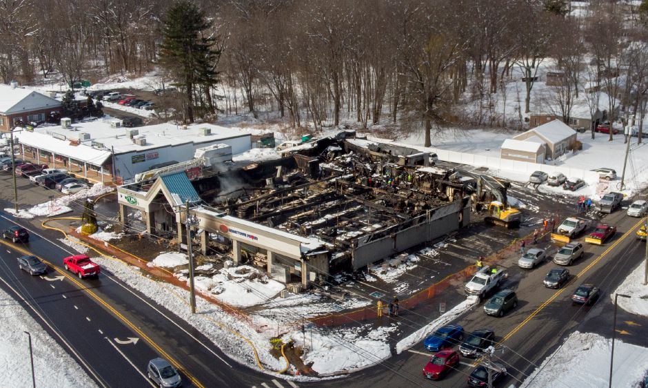 A small plume of smoke rises up from Tops Supermarket in Southington more than 12 hours after a fire tore through the building on the Meriden-Waterbury Turnpike March 4, 2019. | Richie Rathsack, Record-Journal