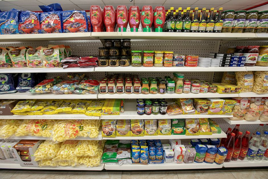 An aisle featuring a variety of Polish foods at Aresco
