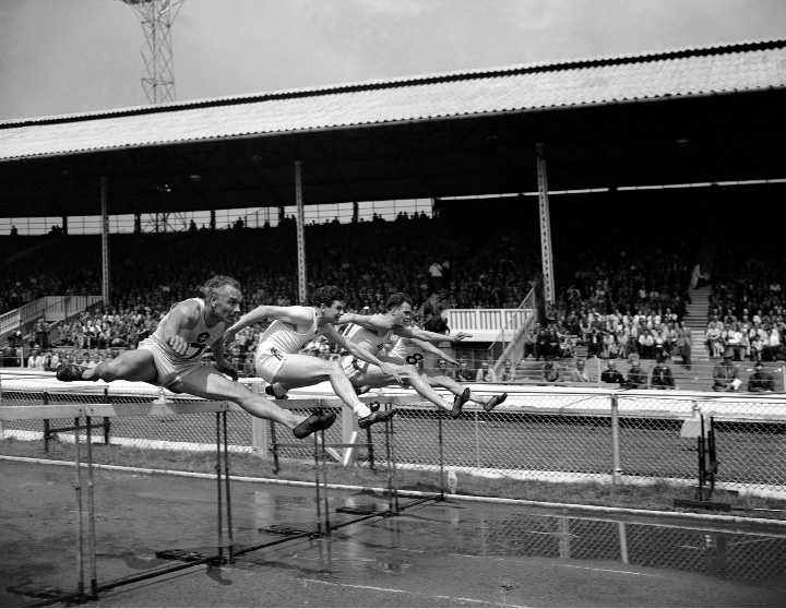 L-R: Donald Finlay of the Milocarian Athletics Club; C.C. Balch; E. M. Rosser ; and Peter Hildreth during the first heat of the 120 Yard Hurdles at the Amateur Athletics Association Championships in White City, London, England on July 16, 1949. Finlay won the race. (AP Photo)