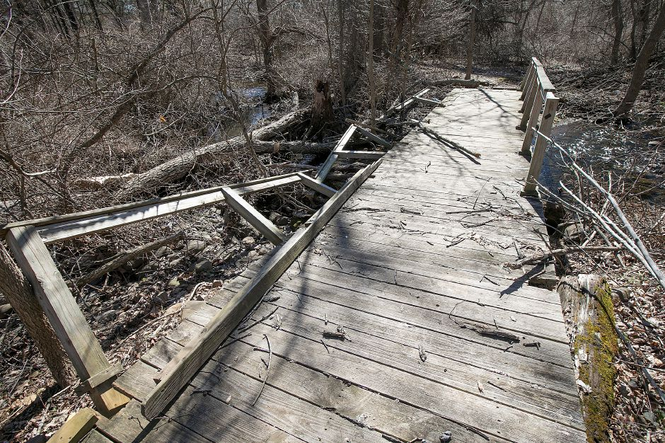 A bridge in disrepair on the Mill River behind Bartlem Park in Cheshire, Tuesday, March 6, 2018. Save the Sound and local residents are working to create a watershed plan that