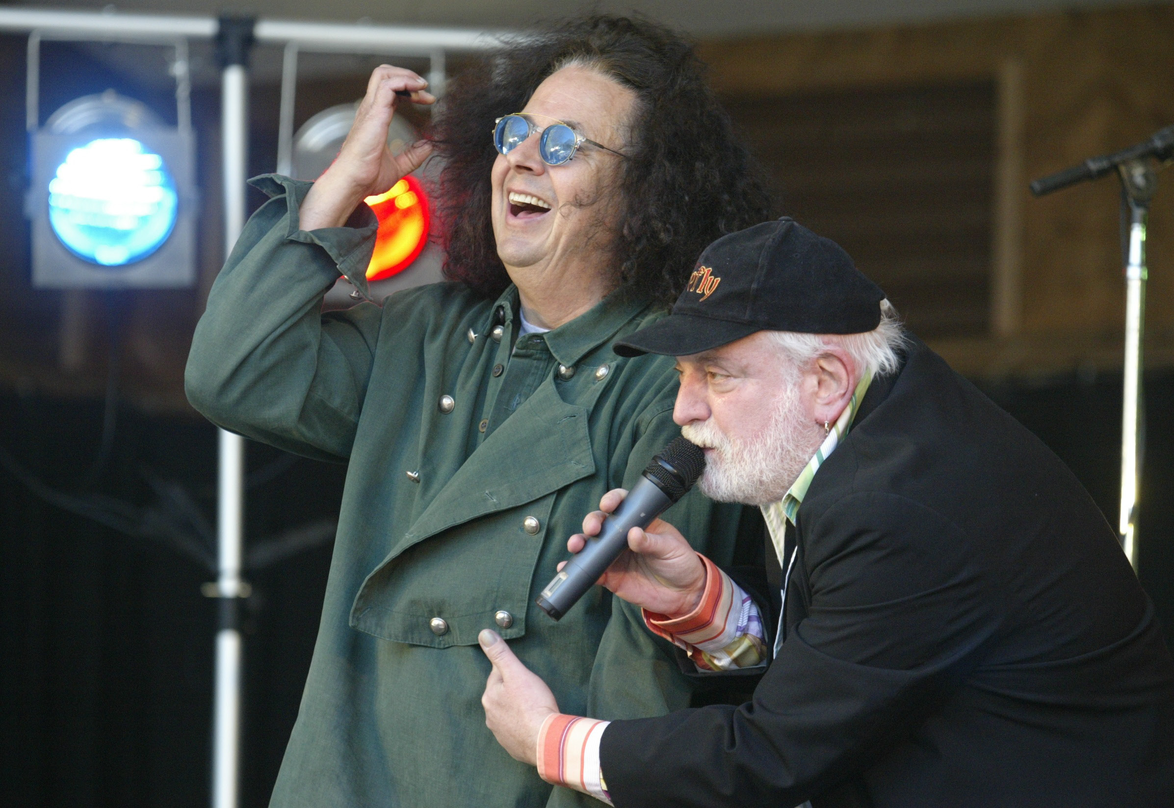 Howard Kaylan, right, pokes fun at his Turtles partner, Mark Volman, during their concert at Hubbard Park for the Meriden Daffodil Festival on pril 29, 2006.
