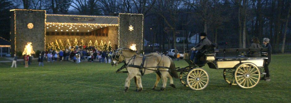 A horse drawn carriage from Allegra Farms rides past the band shell in Hubbard Park during the Christmas festival on Dec. 12, 2006.