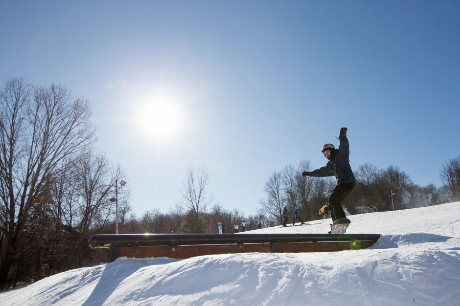 Pat Hoffman of Southington centers his snow board on a rail in the free style section at Mount Southington Ski Area in Plantsville Friday December 29, 2017 | Justin Weekes / Special to the Record-Journal